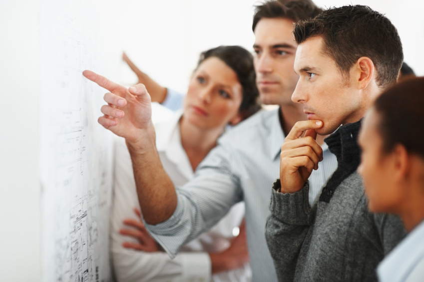 Employees working together review plans