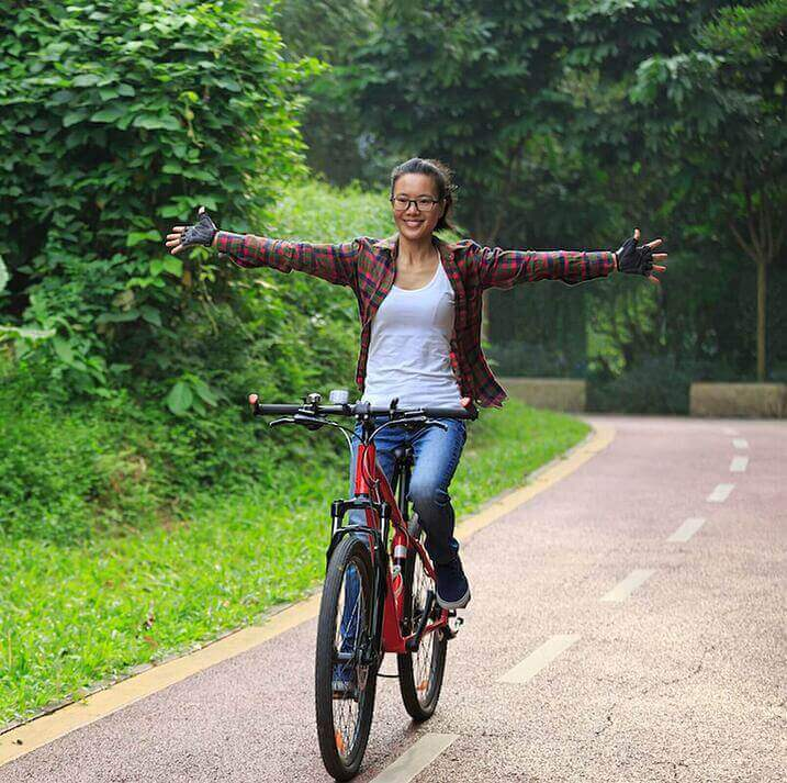 Bicyclist getting exercise after work tiny