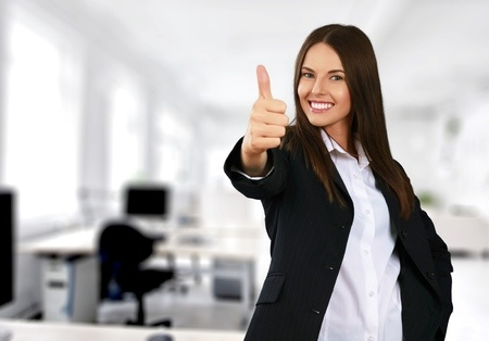 Employee gives the thumbs-up sign